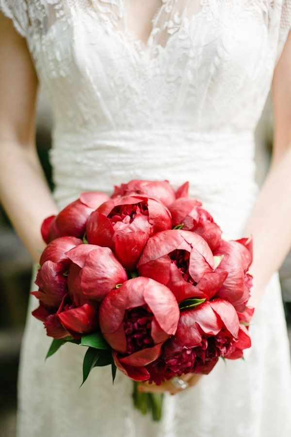 These bright red peonies are absolutely gorgeous...elegant, sophisticated, and so much fun!  From http://stylemepretty.com/new-york-weddings/2012/07/16/brooklyn-wedding-at-prospect-park-wedding-by-brklyn-view-photography/  Photo Credit:  http://brklynview.com/