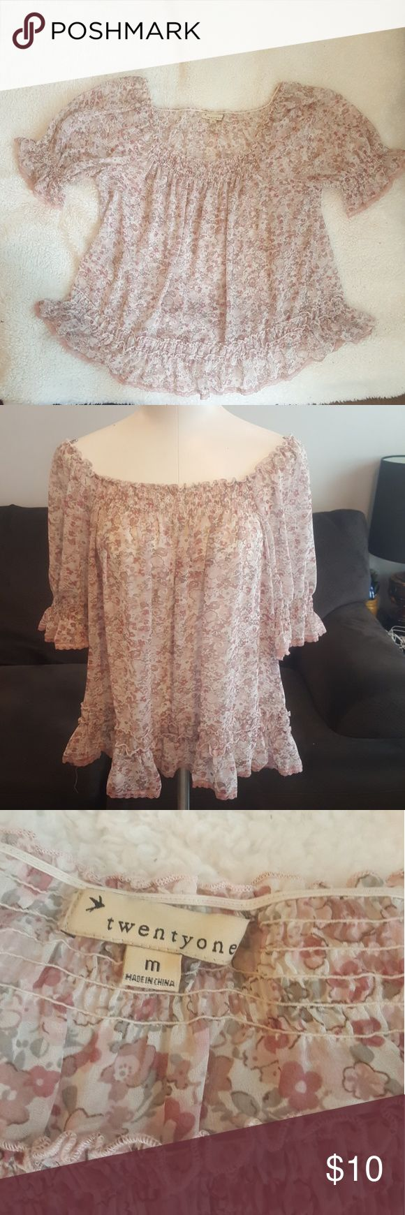 Sheer floral blouse Such a versatile top! I typically wear an xxs-s in tops but opted for a M for a more loose fitting and off the shoulder look. This top will fit xxs-L depending on the fit you are going for. Such a beautiful and delicate floral print! Forever 21 Tops
