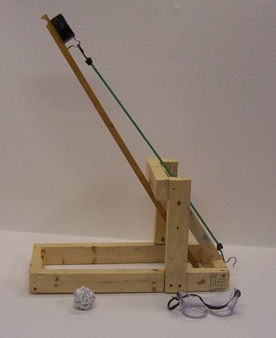 To build a Catapult  http://www.stormthecastle.com/catapult/backyard-ogre-catapult-index.htm