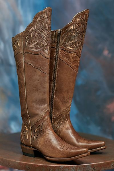 Our Ariat Chaparral Boots feature a classic western style in perfectly distressed leather. A pretty scalloped leather makes this style perfect for autumn ensembles! The padded insole gives them the feel of wearing your favorite tennis shoes!