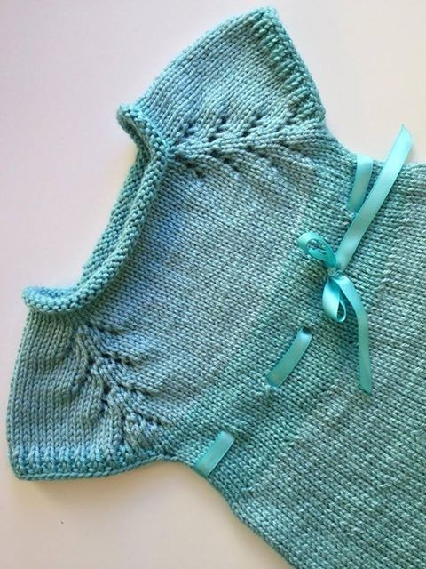 So pretty, both colour choice and construction. Main features: worked Top-down with lace on raglan line; plain stockinette all over, even on the neck which makes it self-rolling; eyelet row for threading ribbon at Empire-waist height. I love Barbara Ajroldi's knitting designs for babies.