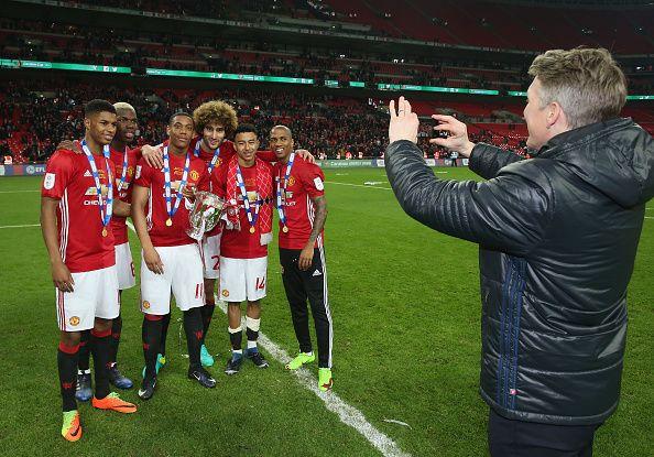 Bastian Schweinsteiger takes a photo of Marcus Rashford Paul Pogba Anthony Martial Marouane Fellaini Jesse Lingard and Ashley Young of Manchester...