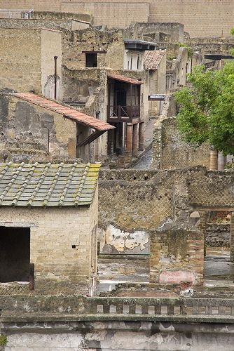 Herculaneum shared the fate of Pompeii when nearby Vesuvius erupted in 79 AD being buried under a thick carpet of ash and rock. The city remained undisturbed for centuries and perfectly preserved until rediscovered in the 1700s.