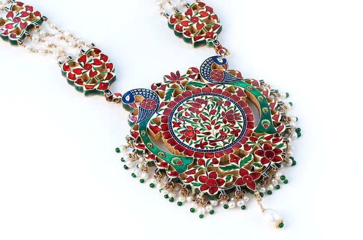 Impressive Jaipur Diamond and Enamel Peacock Medallion Necklace. India, 1920. An impressive Peacock Medallion diamond and natural pearl Jaipur necklace, the magnificent large Peacock Medallion fringed with pearls, suspended from 10 diamond set enameled sections. Purportedly worn by Sarah Bernhardt.