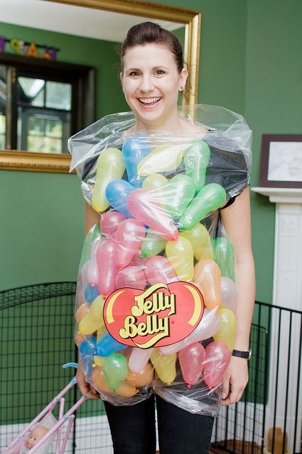 A lady wearing a home made jelly belly costume with little balloons for the jelly beans