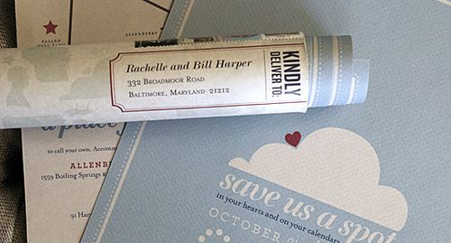 The save the date was a double sided poster, sent in a custom designed and wrapped mailing tubes.