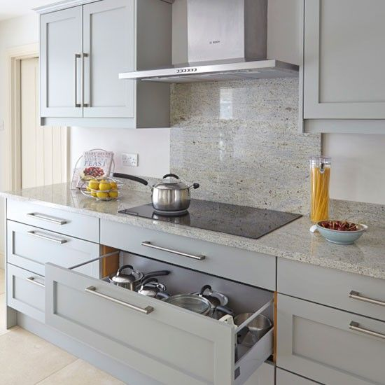 Grey kitchen with marble splashback