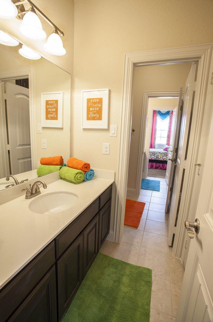Serene model homes tulum jackandjill bathroom green for Blue and orange bathroom