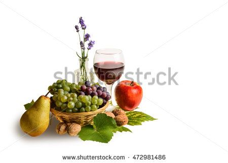 autumn background with grapes, wine, lavender, apple, pear and walnuts isolated on white.