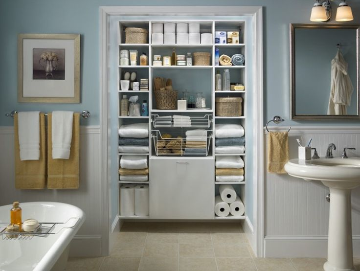 Traditional bathroom with walk in closet open shelves a freestanding tub and a pedestal sink rectangular mirror blue and white wall of Beautiful Bathroom Organizers for Small Bathrooms Ideas
