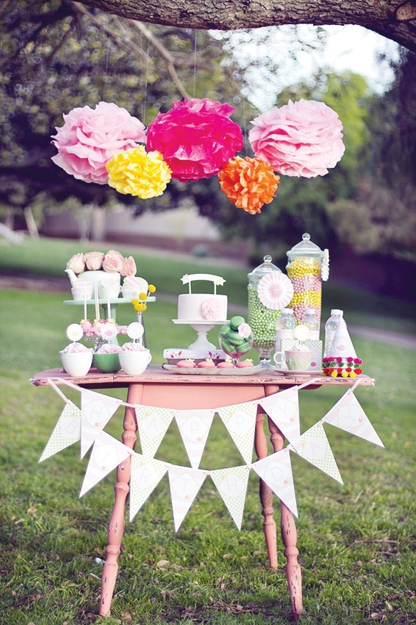 Tea party birthday table. Love the Pom poms and flowers in the tea pot