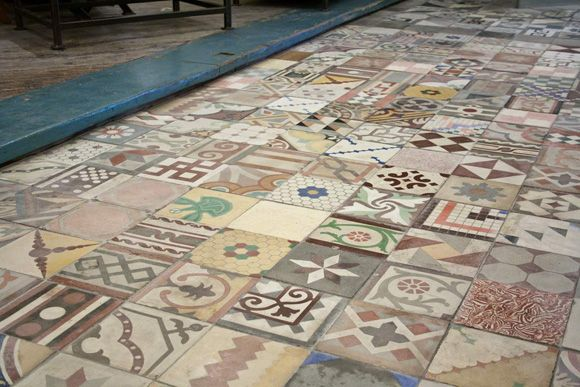 Patchwork floor tiles by The Reclaimed tile Company in The Old Cinema, Chiswick