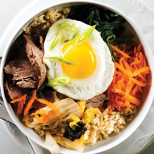 This signature Korean dish is like a deconstructed version of fried rice. And it's up to the diner to mix everything together!