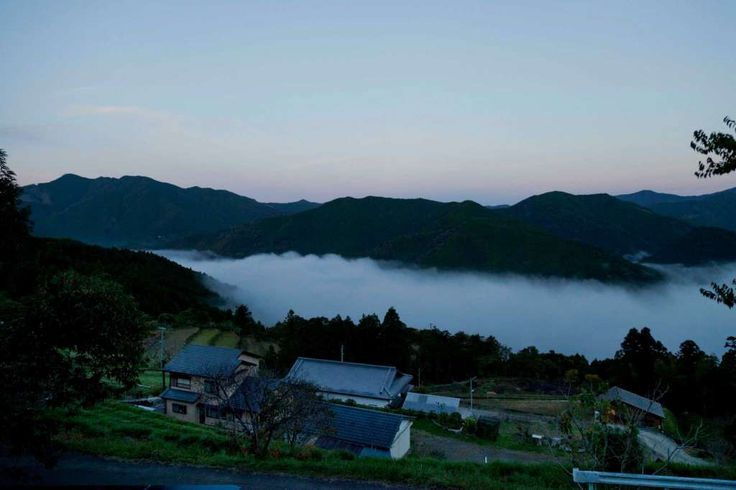 A view of the hamlet of Takahara and the fog-shrouded valley below, along the Kumano Kodo religious pilgrimage trail on Japan's Kii peninsula.. Beautifully preserved Edo-era towns and shrines, traditional guesthouses, hot springs and verdant mountainsides are just some of the features drawing travelers to the Kumano Kodo.