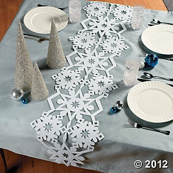 Snowflake Table Runner - I like the idea of a snowflake runner, but don't think I'd like it in foam. Perhaps I would do it in felt or paper with a little bling added.