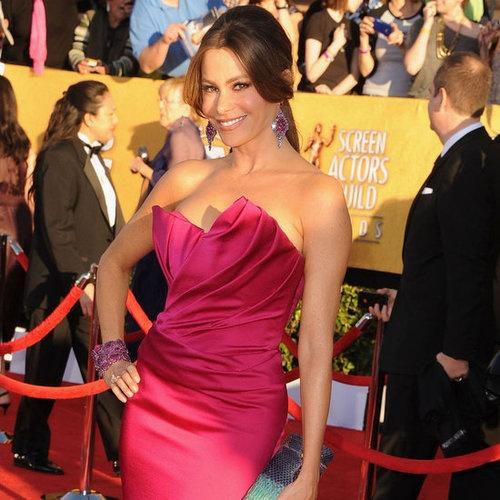 Sofia Vegara rocks the red carpet again in a beautiful fuchsia strapless.