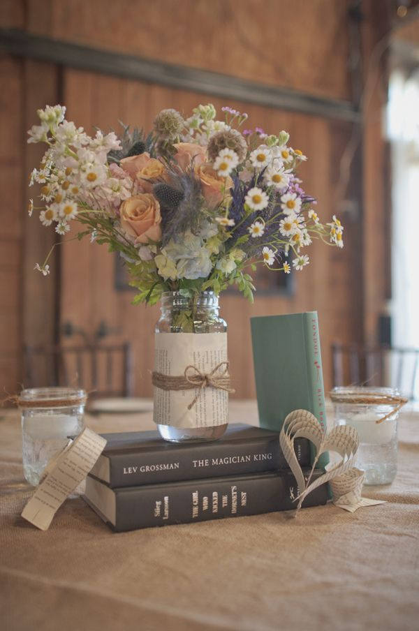 """book"" wedding....pages as decor, etc.  neat! A little overload with the hearts but the mason jar and book combo is CUTE!"
