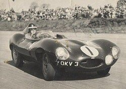 Mike Hawthorn at Silverstone in Jaguar D-type, Chassis XKC 404, where he broke the lap record. The photograph is signed and is courtesy Gary Oxley