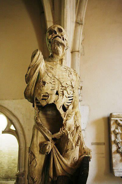 skeleton sculpture in a crypt