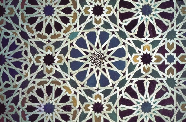 Image SPA 0201 featuring decorated area from the Alhambra, in Granada, Spain, showing Geometric Pattern using ceramic tiles, mosaic or pottery.