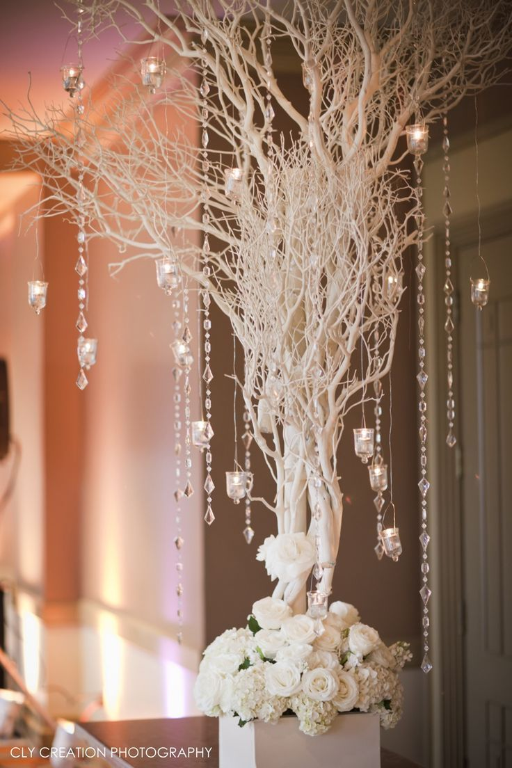 all white tree wedding decor with crystal garlands for winter wonderland wedding theme