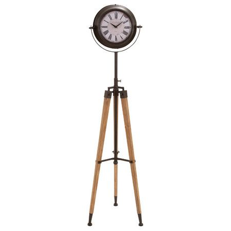 With a wood tripod base and swiveling face, this floor clock offers vintage-inspired appeal to your decor.   Product:  Floor clo...