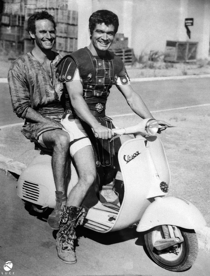 Stephen Boyd and Charlton Heston riding on the set