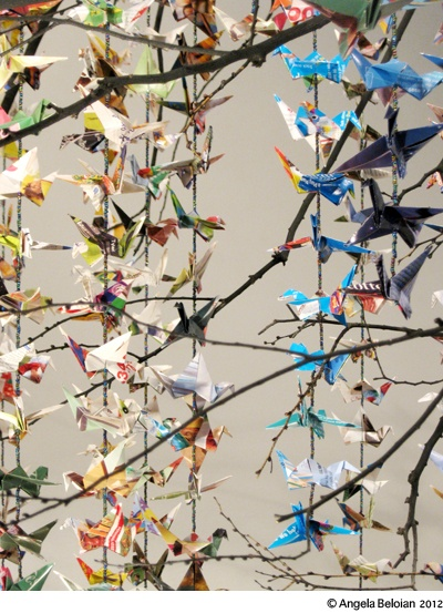 1000 cranes folded from mail order catalogues by Angela Beloian