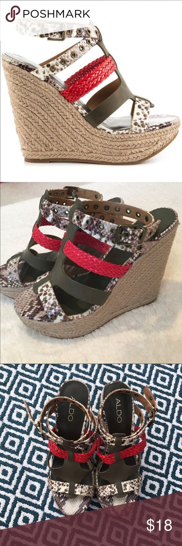 Aldo 🌹Snake Print/Multi Color Wedges These give wedges a little sass with its snake print , army green , and a splash of red Combination. They are in Great Condition and Very comfortable like all wedges 😘 Aldo Shoes Wedges