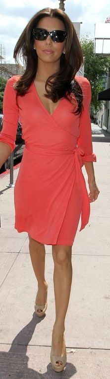 Love her hair, wrap dress, and nude pumps