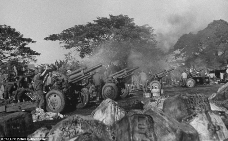 Fire: American artillery crews of 1st Cavalry Division firing on Japanese positions from the grounds of the recently liberated Santo Tomas University during the Battle for Manila.
