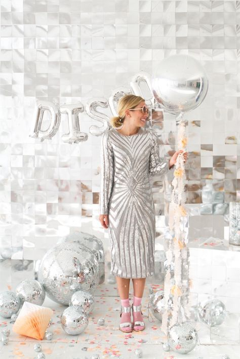 Bookmark this disco ball DIY project ideas to make New Year's Eve party decor like this glittery photo booth backdrop.
