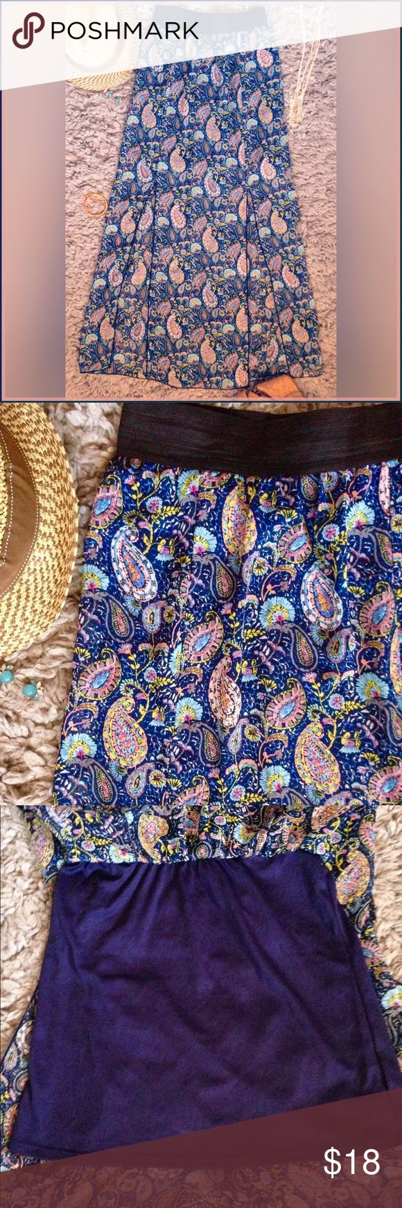Sheer Long Maxi Skirt Socialite Clothing sheer maxi skirt with paisley pattern. Beautiful chiffon material over shorter navy skirt! Two slits give a nice draping and flow effect. Pull on and stretch band top for easy wear. Polyester blend. Gently worn once, in perfect condition. Socialite  Skirts Maxi