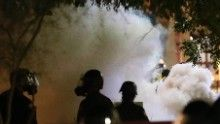 Smoke billows after Phoenix police used tear gas outside the convention center where President Trump hosted a rally Tuesday night.