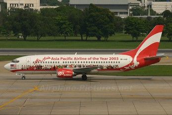 AirAsia (MY) Boeing 737-3L9 9M-AAB aircraft, with the sticker ''AirAsia Asia Pacific Airline of the Year 2003'' on the airframe, skating at Thailand Bangkok Don Muang International Airport. 17/04/2005. (The plane has been stored).