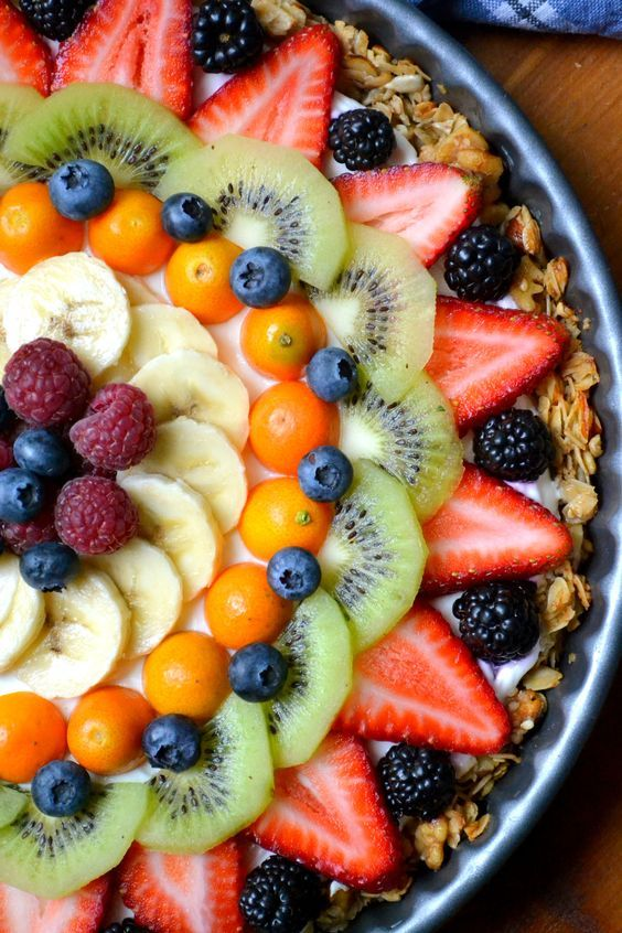 Beautiful Breakfast Tart made with granola crust, yogurt filling, and fresh fruit.