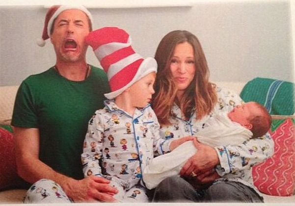 The Downey family's 2014 Christmas card.  It's Susan Downey and her three kids...in their matching Peanuts jammies! #robertdowneyjr