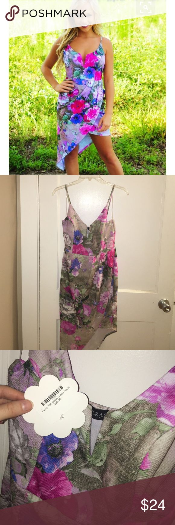 "Floral Asymmetrical Dress Brand new with tags! Never been worn! Originally purchased online from ShopHope's. In perfect condition. The material does stretch. Straps are not adjustable. It has built in padded cups. It runs true to size and is supposed to be a more ""fitted"" dress. Shop Hope's Dresses Asymmetrical"