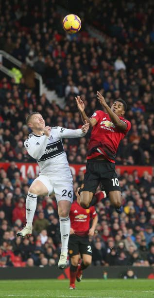 4a303b148ea Marcus Rashford of Manchester United in action with Alfie Mawson of Fulham  during the Premier League match between Manchester United and Fulham FC at.