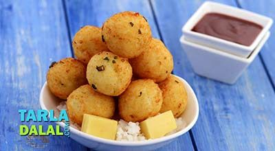 There are many interesting ways to make use of leftover rice including some types of rotis and dosas. But, this recipe tops the charts! Rice and Cheese Balls, made with cooked rice flavoured simply with green chillies and mustard powder and bound together with flour, gives rise to a temptingly crisp snack when deep-fried. What is more, the procedure is as simple as mix, shape, and fry. No dipping, no rolling, no sweat!
