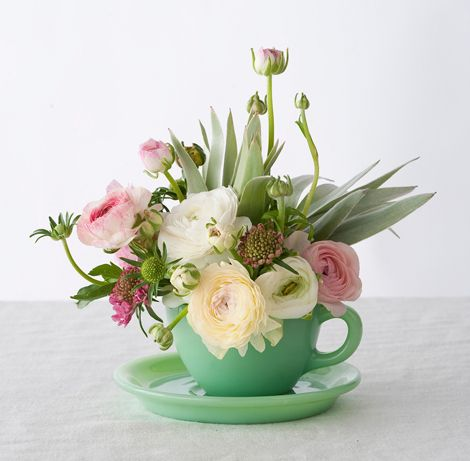 teacup flower arrangements- so cute!  would be great along the center runner of a long table, with a few arrangements in teapots interspersed.