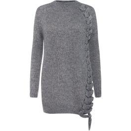 Sweter z dodatkiem wełny moherowej z ozdobnym wiązaniem. Model o luźnym kroju.\r\nModelka ma 180 cm wzrostu i nosi rozmiar S.