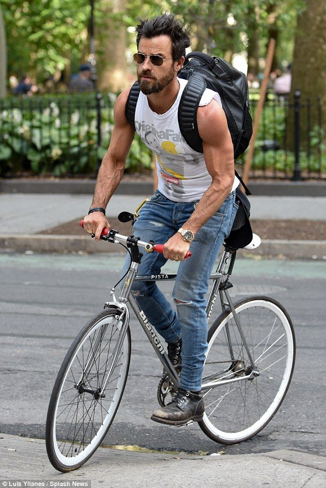 Pedal power: Justin, 44, is an outdoorsy type who loves to stay fit in the fresh air. He showcased his rippling muscles and pumped biceps as he tooled around the city streets on Tuesday