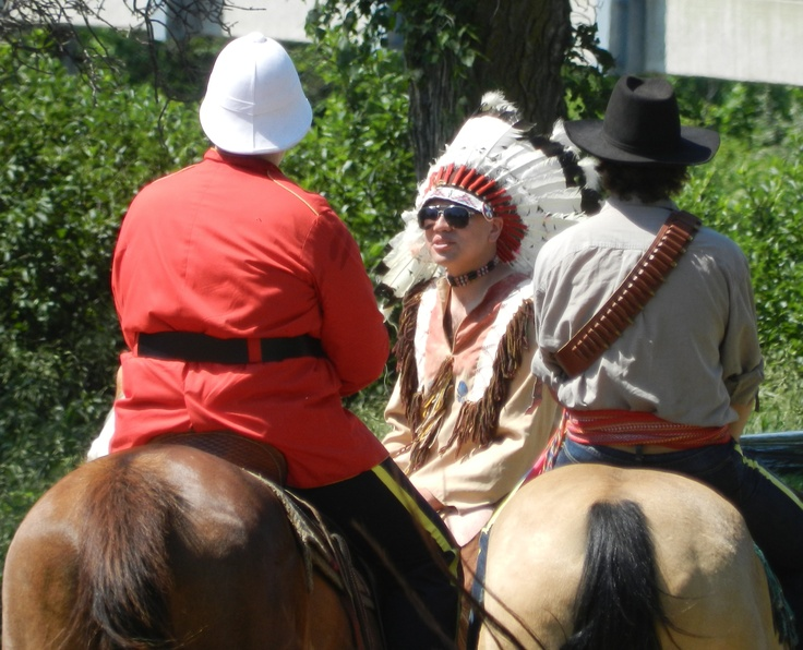 Reenactors portraying a NorthWest Mounted Police officer, a Metis interpreter, and Chief Sitting Bull prepare for the 2012 Burning Sun Production of The Medicine Line performed on location in the Wakamow Valley, Moose Jaw, Saskatchewan. http://www.inkwellinspirations.com/2012/08/the-medicine-line-outdoor-show.html