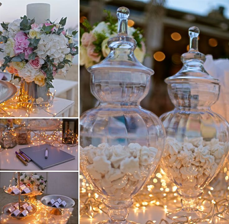 Elegant detail...Crystal vases with sweets, the wish book and the pastel coloured flower compositions!