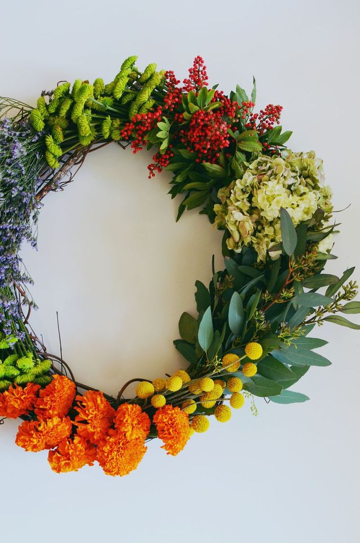 use fresh flowers and let dry on the wreath