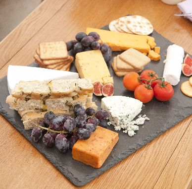 Make a statement with this extra large slate board. Suitable for many uses including the popular uses as a cheeseboard, centrepiece, serving platter etc. This extra large piece is sure to impress those lovely friends and family at your next gathering.  Why not have your item personalised? Yes,  we offer a full bespoke engraving service for customers wanting to add something a liitle special their slate gift. Feel free to ask any questions via the contact box on the contact page.