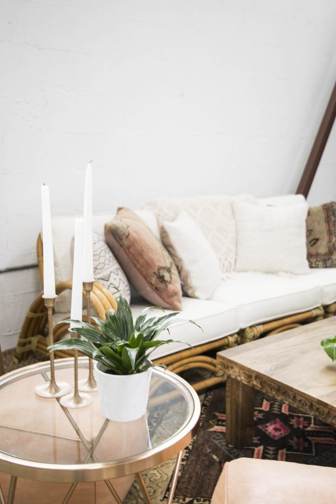 Neutral Lounge with Rose Gold Side Table and Candlesticks, Carved Wooden Coffee Table and Rattan Beige Sofa | Bloguettes Blogging Workshop: Austin via Birch & Brass Vintage Rentals for Weddings and Special Events in Austin, Texas