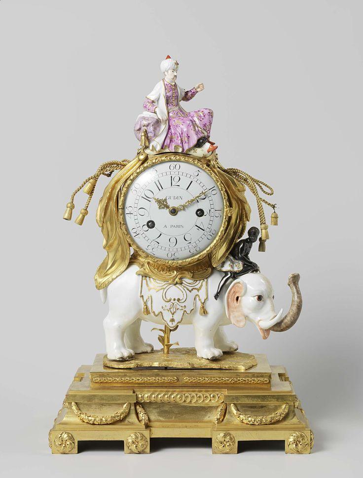 Anonymous | Mantle clock (pendule), Anonymous, Meissener Porzellan Manufaktur, c. 1753 | Klok die wordt gedragen door een olifant van polychroom porselein. De olifant staat op een rechthoekig verguld bronzen voetstuk met decoratie van geteld geld, rozetten en guirlandes. Bovenop de klok zit een sultan (afneembaar), en op de nek van de olifant zit een zwarte man. Het porselein is niet gemerkt.