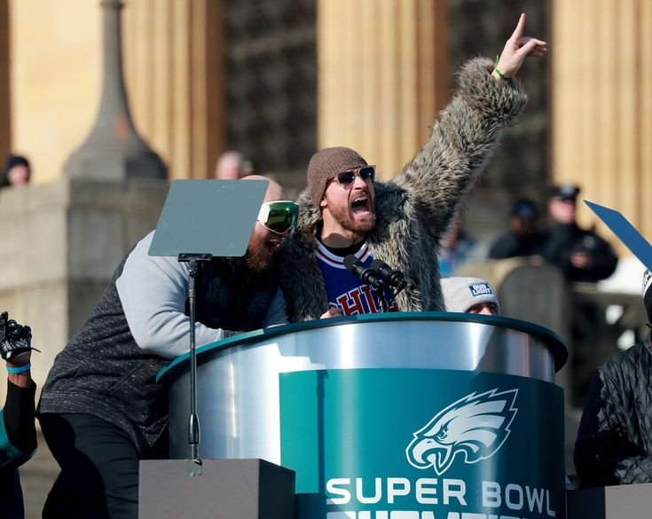 Eagles DE Chris Long and Eagles T Lane Johnson lead the crowd in an Eagles Fight Song during the Super Bowl parade at the Philadelphia Museum of Art, Thursday, Feb. 8, 2018.